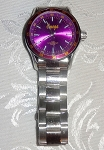 Omega Watch with Purple Dial Face